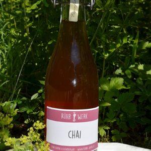 Flasche mit Chai Punsch. Ein Gewürzauszug der mit Rohrohrzucker zum Punsch gekocht wird. Geeignet für Chai Latte oder Lassie.