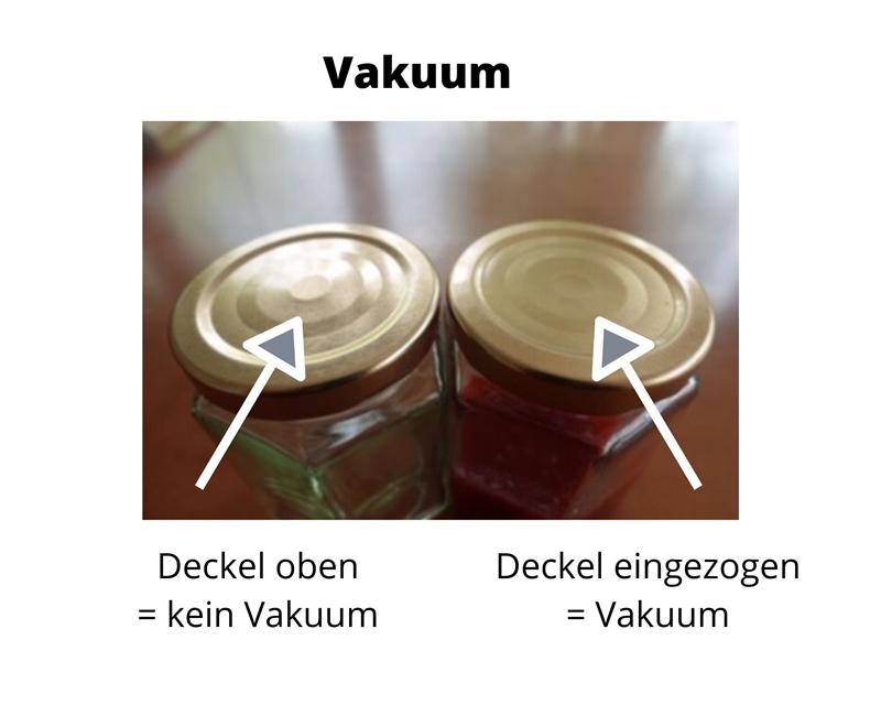Zwei Marmeladengläser, der eine Deckel gewölbt, der andere durch das Vakuum nach unten gezogen